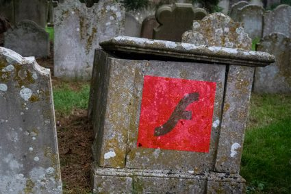 A tombstone with the Adobe Flash logo